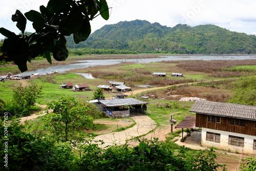 Plexiglas Beige View of the river and surrounding communities of the dam near the Mon Bridge at Khao Laem Dam, Sangklaburi, Thailand.2018 May 5