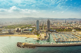 Barcelona aerial, Port Olimpic with city skyline, Spain. Helicopter view
