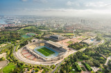 Barcelona aerial panorama, Anella Olimpica sport complex on the hill with city skyline , Spain. Late afternoon light