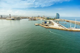 Aerial wide angle view of Barcelona port and marina with city skyline, Spain