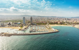Barcelona skyline aerial view skyscrapers by the beach, Spain. Vintage colors