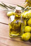 olives and bottle of extra virgin olive oil on wood - 204724806