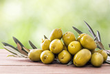 olives on wood with background - 204725410