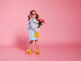 funny child girl fashionista in big mother's   shoes on colored background - 204728219