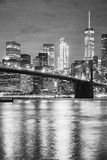 Black and white picture of the Brooklyn Bridge and Manhattan at night, New York City, USA.
