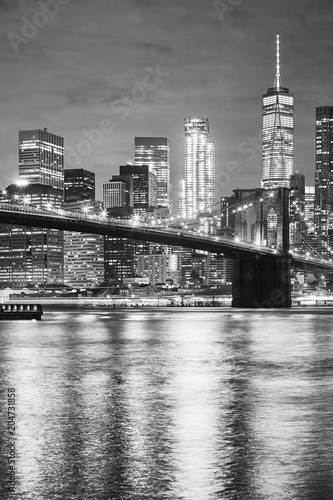 Black and white picture of the Brooklyn Bridge and Manhattan at night, New York City, USA. © MaciejBledowski
