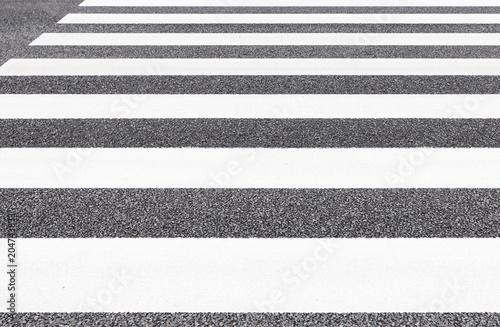 Fototapeta Close - up Zebra crossing pattern on city road
