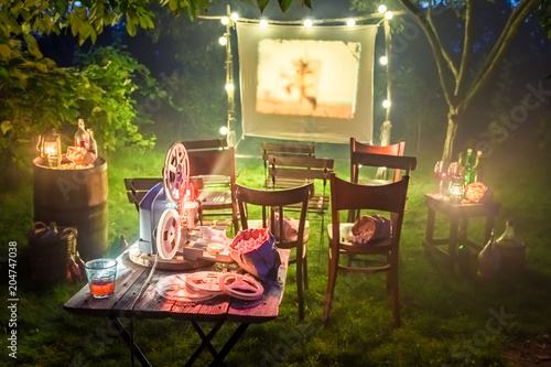 Foto Murales Small cinema with old analog films in summer evening