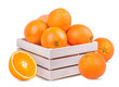 Juicy oranges  in a box isolated on white background with clipping path