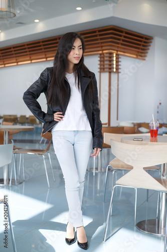 A cute brunette Asian girl in sunglasses.