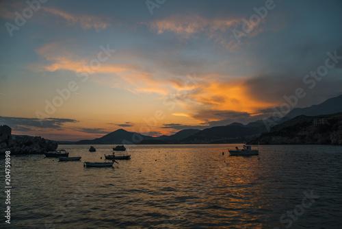 Plexiglas Zee zonsondergang Fishing boats in sea, spectacular sunset, near Budva, Montenegro