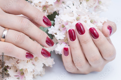Plexiglas Manicure Attractive manicure on women's hands. Natural finger nails with stylish nail art.
