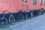 Motorcycle and wooden gate on the Old Town street in Stockholm,