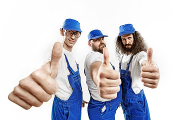 Three brave craftsmen making an