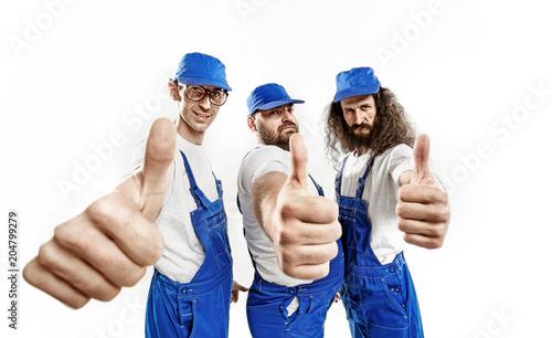 Foto Spatwand Konrad B. Three brave craftsmen making an