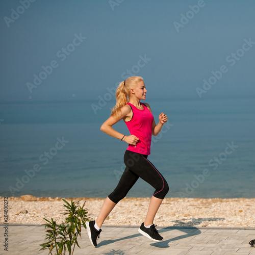 Fotobehang Hardlopen jogging in th beach - woman runns near sea on early summer morning