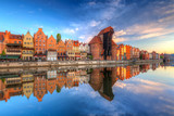 Beautiful old town of Gdansk reflected in Motlawa river at sunrise, Poland. - 204802607