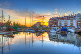 Beautiful marina with yachts in Gdansk reflected in the river at sunrise, Poland. - 204802643