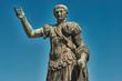 Rome, Bronze statue of emperor Caesar Nervae Trajan, Forum of Caesar Nervae Trajan in the background