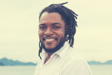 Laughing african american guy with dreadlocks in vintage retro look