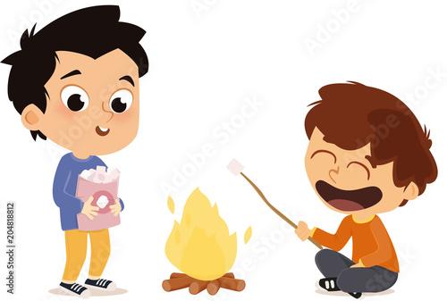 garçons faisant un feu de camp