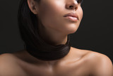 Close up of calm woman with hair wrapped around her neck. She is naked. Isolated on black background - 204829074