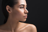 Close up of calm woman showing beautiful profile of her face. Copy space in right side. Isolated on black background - 204829631