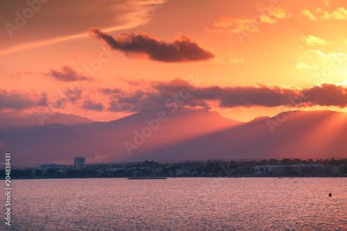 Fotobehang Koraal Colorful sunset over spanish coastline
