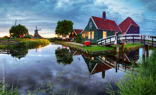 Traditional dutch windmill near the canal. Netherlands, Landcape at night