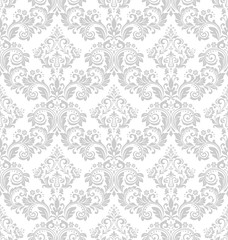 Wallpaper in the style of Baroque. A seamless vector background. White and grey floral ornament. Graphic pattern for fabric, wallpaper, packaging. Ornate Damask flower ornament.