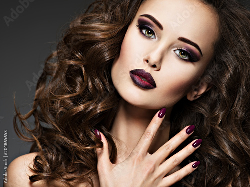 Beautiful woman with maroon nails