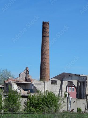 Fotobehang Oude verlaten gebouwen Brick factory chimney. Abandoned enterprise. The old boiler plant.