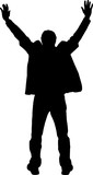 Silhouette of a man with his hands up.