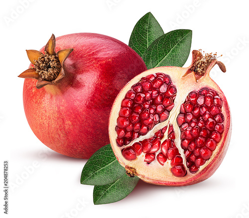 Foto Murales Ripe pomegranate fruit and one cut in half with leaf