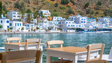 Restaurant tables with view on the scenic village of Loutro  in Crete, Greece - 204880484