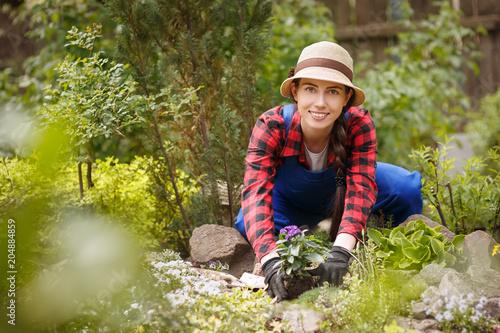 Fridge magnet woman gardener planting flower in soil