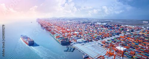 Leinwandbild Motiv Container ship leaving the port