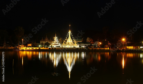 Plexiglas Thailand Buddhist temple stupa at night time covered in lights, Northern Thailand, Southeast Asia
