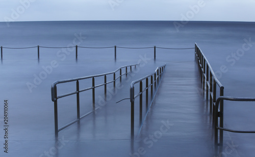 Acrylglas Pier Stormy Morning at Collaroy Rockpool