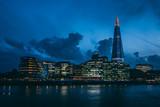 Modern London skyline on River Thames at night - 204910667