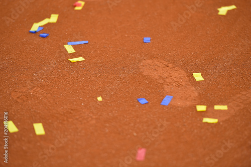 Plexiglas Tennis Confetti on a tennis clay court