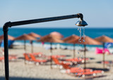 Shower pouring water at the Agios Ioannis beach in the area of Mount Pelion in Greece in summer