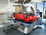 Modern concept of auto repair work Details of the red car on the surgical table 3D render