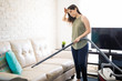 Quadro Home and cleanliness - Woman cleaning sofa