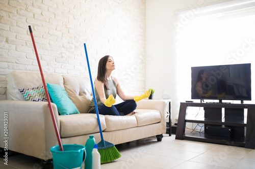Woman taking a break from cleaning home