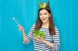 Smiling girl wearing paper golden crown eating dieting food sala