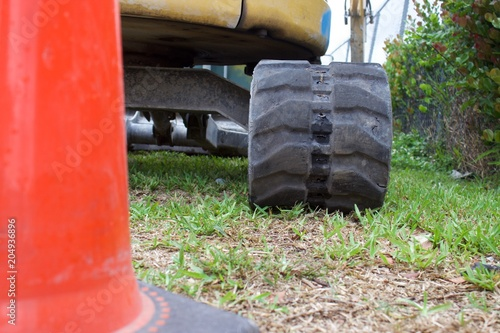 Aluminium Trekker ground view of mini excavator track behind traffic cone