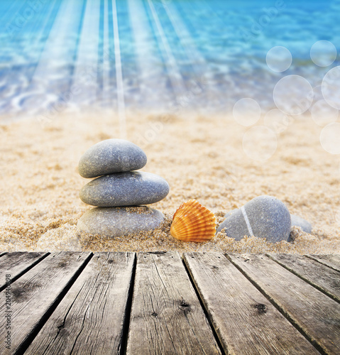 Fotobehang Zen Stenen piedras en la arena de la playa