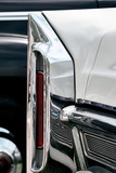 Closeup of a wing and rear light of a luxury retro Cadillac Coupe de Ville.