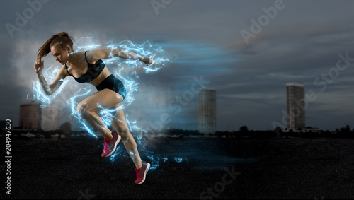 Woman sprinter leaving starting blocks on the athletic track © Andrey Burmakin